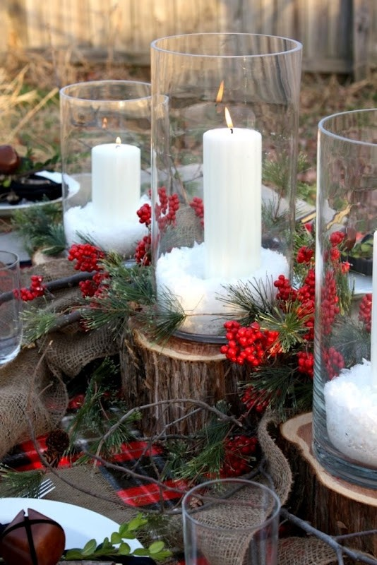 Christmas candles in glass vases with ornamental snow