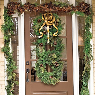 Christmas Front Door Decorated With Stacked Wreaths