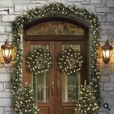 Double Christmas Front Door with Twinkle Lights, Garland, and wreaths