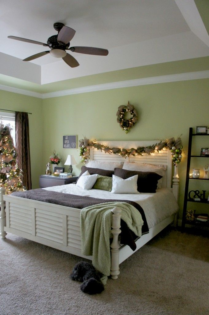 Bed decorated with Christmas garland